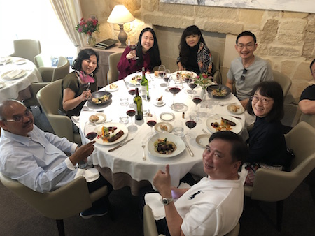 The 2018 Bordeaux Grand Cru Harvest Tour II savoring an exquisite lunch in Saint Emilion
